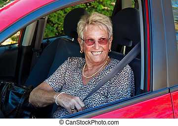 senior as a car driver in the car. - elderly woman with a...
