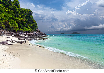 A tropical island with sandy beach