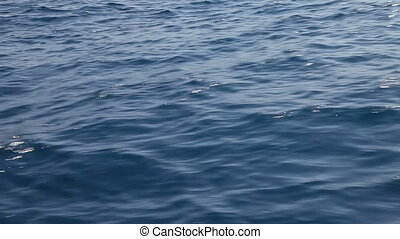Red sea water nature background. Low angle view from boat
