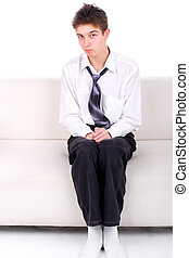Shy Teenager on the Sofa isolated on the White background