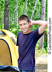 Teenager in the Camp - Happy young Man camping in the forest