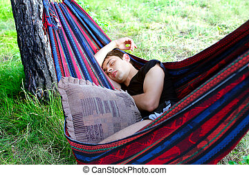 Young Man Sleeping - Young Man sleeping in the Hammock on...