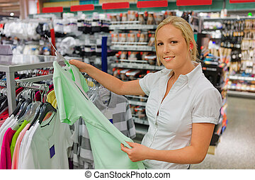 woman when purchasing clothing - a young woman on the...