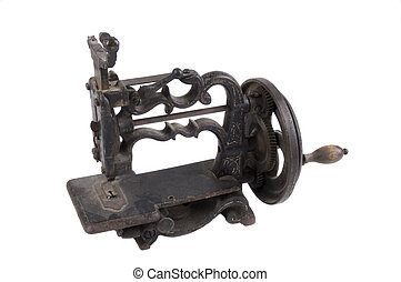 Antique minature hand crank sewing machine isolated on white