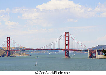 Golden gate bridge from the Presidio, with sail boats and a...