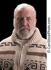 old man with beard in sweater like Ernest Hemingway