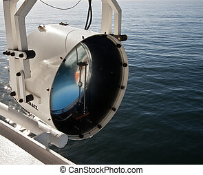 Ship Search Light - Powerful ships searchlight against a...