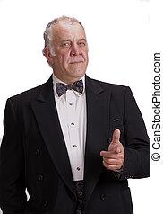 older businessman impersonating James Bond - older...