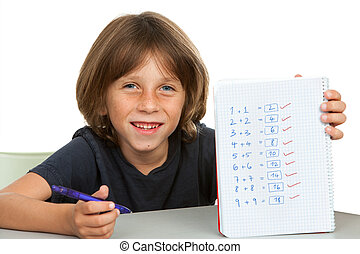Cute kid showing notebook with math problems - Portrait of...