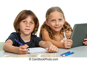 Portrait of two young students at desk.