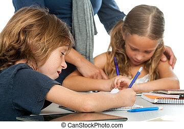 Teacher supervising kids homework. - Close up of teacher...