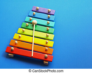 music - xylophone - a colorful wooden xylophone over a blue...