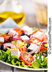 greek salad - salad with fresh vegetables and feta cheese