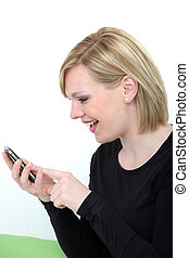Excited woman reading a text message