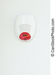 Alarm device on a white wall