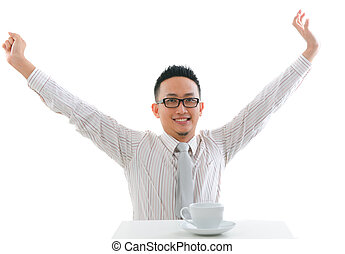asian man having tea or coffee break with raised hands