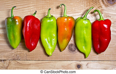 organic sweet bell peppers on wooden board background
