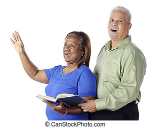 Couple Sings Praises - A senior African American couple...
