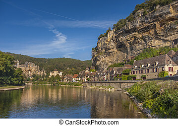 Medieval village of Roc Cageac - River view of the town of...