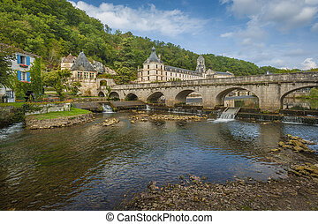 Medieval town of Brantome - River view of the town of...