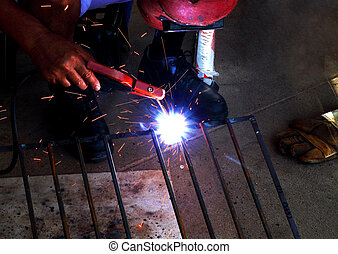 worker welding connecting square bar  without gloves