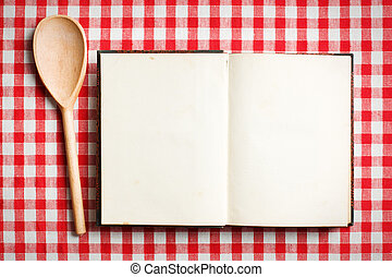 open old recipe book on checkered tablecloth
