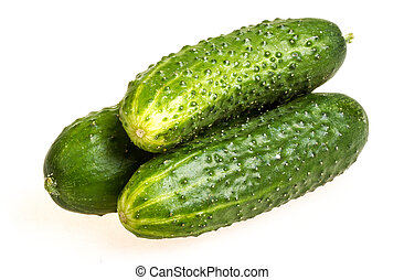 Healthy food. The green cucumbers isolated on white...