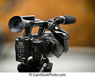 hot news - professional camcorder on the tripod, selective...