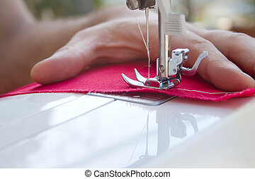 Hands of tailor sewing clothes - Closeup details of tailors...