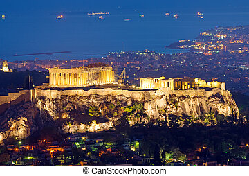 The Acropolis at night - The Acropolis in Athens, Greece, at...