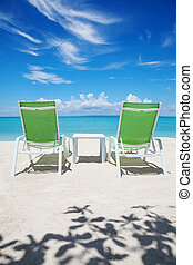 Take a break on paradise beach - Two deckchairs on a...