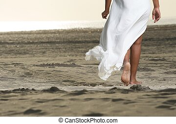 Walking Forward - An African American girl is walking on the...