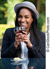 Portrait of a Beautiful Smiling African American Girl Drinking Tea