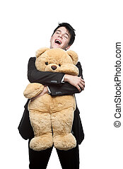 happy smiling businessman embracing big soft toy - young...