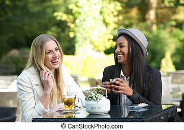 Multicultural Friends Laughing and Drinking Tea -...