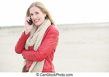 Smiling Blond Talking on the Phone - Beautiful Blond is...
