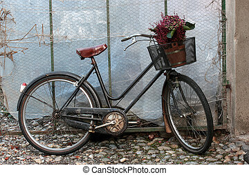 bicycle flowers - old black bicycle with flowers in the...