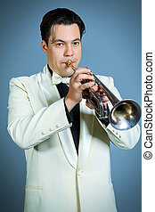 trumpeter - Portrait of a musician playing the trumpet at...