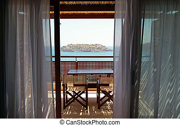 Open balkony with furniture and sea view(Crete, Greece). -...