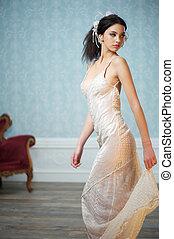 Elegant Bride Looking Over her Shoulder - An elegant young...