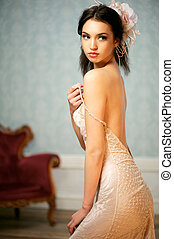 Portrait of a Beautiful Bride Holding Her Shoulder Strap - A...