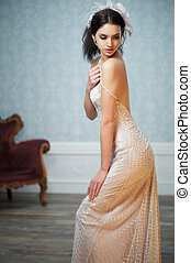 Beautiful Bride Glancing Over Shoulder - A young girl in a...