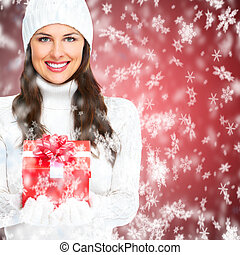Beautiful young Christmas girl with a present - Beautiful...
