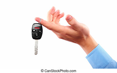 Hand with a car key Isolated on white background