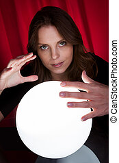 Fortuneteller with glowing ball - Beautiful young...