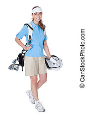 Golfer with a bag of clubs - Attractive female golfer in...