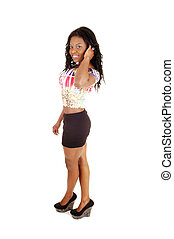 Standing young black girl. - A slim young black woman...