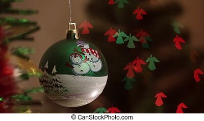 Christmas-tree decorations on angel-shaped background