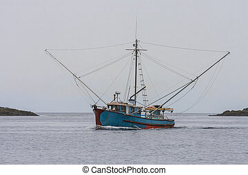 Blue Shrimp Boat on Grey Day - A blue shrimp boat trolling...