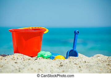 Childrens beach toys - buckets, spade and shovel on sand on...
